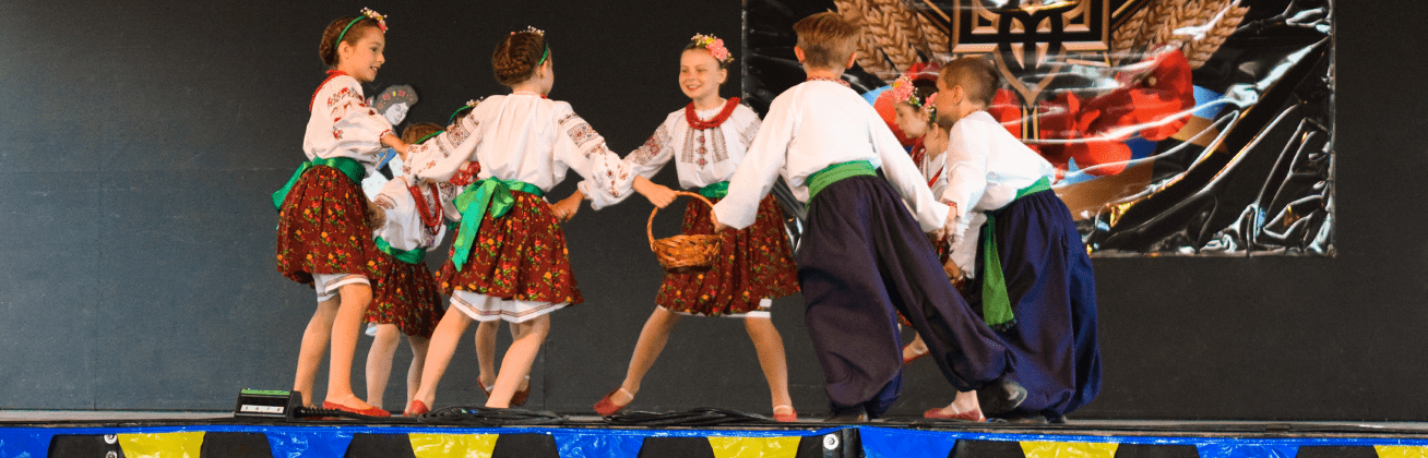 Chaban slideshow image of dancers on stage as a junior group for homepage